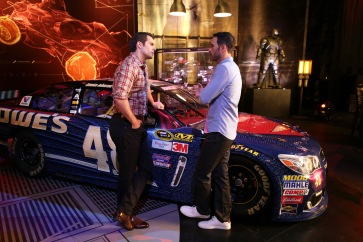 """""""Batman v Superman: Dawn of Justice"""" star Henry Cavill gets an in-depth look at Jimmie Johnson's No. 48 Superman Chevrolet at Warner Bros. Studios on Thursday, March 17, 2016, in Burbank, CA. (Photo by Eric Charbonneau/Invision for Warner Bros./AP Images)"""