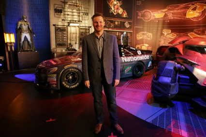 """Dale Earnhardt Jr. poses in front of his """"Batman v Superman: Dawn of Justice"""" film-inspired No. 88 Batman Chevrolet at Warner Bros. Studios on Thursday, March 17, 2016, in Burbank, CA. (Photo by Eric Charbonneau/Invision for Warner Bros./AP Images)"""