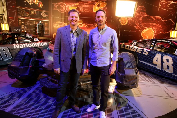 """Dale Earnhardt Jr. and Jimmie Johnson pose in front of """"Batman v Superman: Dawn of Justice"""" film-inspired No. 88 Batman Chevrolet and No. 48 Superman Chevrolet at Warner Bros. Studios on Thursday, March 17, 2016, in Burbank, CA. (Photo by Eric Charbonneau/Invision for Warner Bros./AP Images)"""