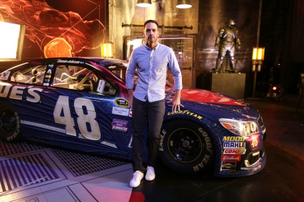 """Jimmie Johnson poses in front of """"Batman v Superman: Dawn of Justice"""" film-inspired No. 48 Superman Chevrolet at Warner Bros. Studios on Thursday, March 17, 2016, in Burbank, CA. (Photo by Eric Charbonneau/Invision for Warner Bros./AP Images)"""