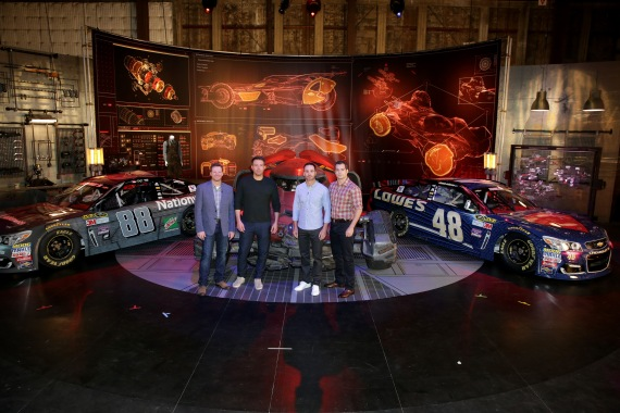 """""""Batman v Superman: Dawn of Justice"""" stars Ben Affleck and Henry Cavill get an in-depth look at Dale Earnhardt Jr.'s film-inspired No. 88 Batman Chevrolet and Jimmie Johnson's No. 48 Superman Chevrolet at Warner Bros. Studios on Thursday, March 17, 2016, in Burbank, CA. (Photo by Eric Charbonneau/Invision for Warner Bros./AP Images)"""