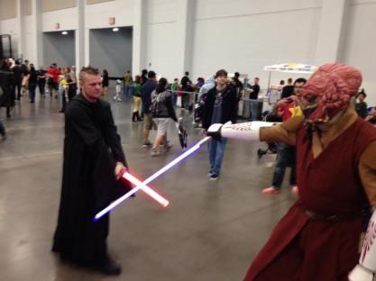 Master Koon crosses lightsabers