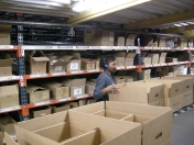 Currently (left) boxes move through the warehouse and the picking team uses automated headsets to pick products from their assigned area and place them in the box as it moves through